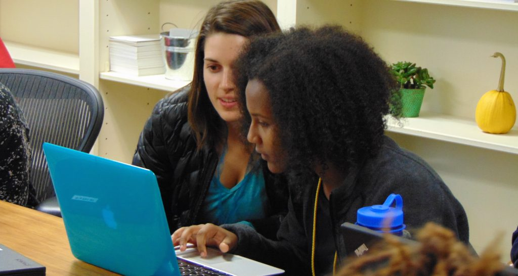 young women working together on html and css