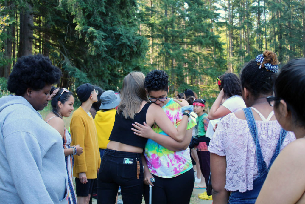 youth campers hugging